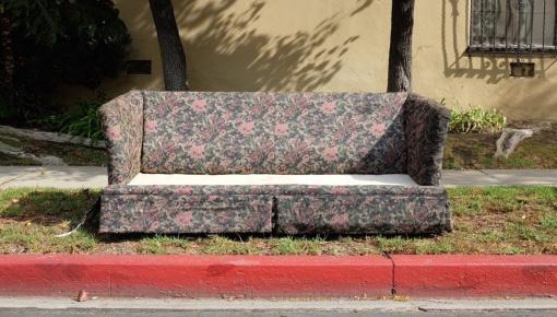 sofa on sidewalk