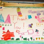 Art on Note from Mrs. Altoon's kindergarten class thanking NHNENC for buses to field trip