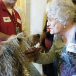 Florence Dorick at city hall with dog