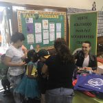 NHNENC table at Halloween event in the gym