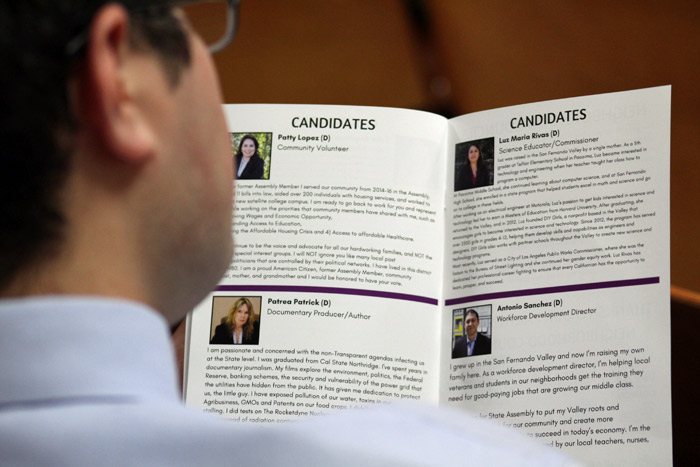 Person looking at candidate brochure