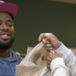 NOLP person giving food bag