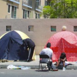 tents in front of housing